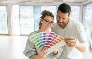 Couple choosing a color of paint